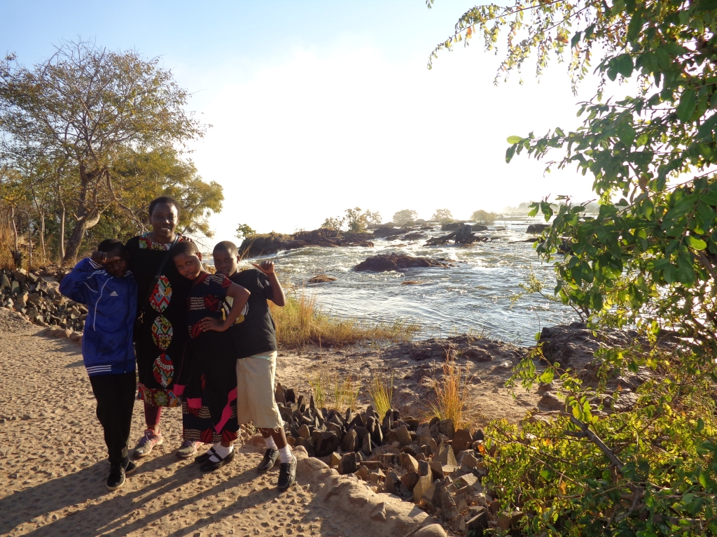 Bettie and the kids near the Zambezi River rapids